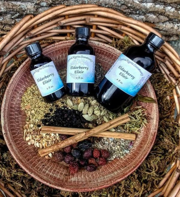 elderberry elixir syrup by spiral roots sanctuary in a basket