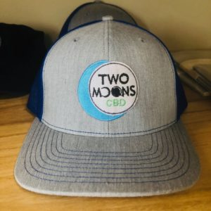 two moons cbd tan and blue hat with logo